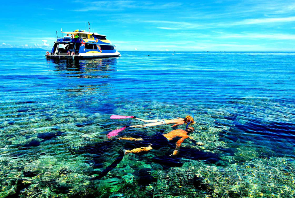 Snorkeling on Opal Reef off Port Douglas on a very calm day.